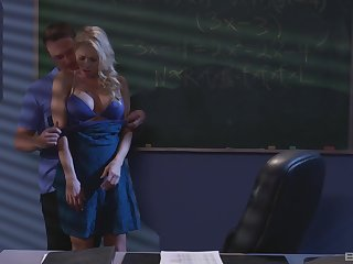 Katie Morgan and a guy enjoy thing embrace and a blowjob in the dark classroom