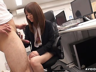 Naughty Asian co-worker Kimoko Tsuji gives a footjob with an increment of blowjob in the office